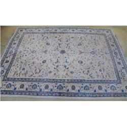An Indo Persian Kashan Wool Rug.