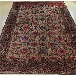 An Antique Persian Sultanabad Wool Rug.