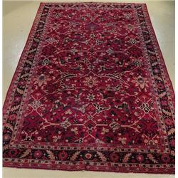 An Antique European Sultanabad Hook Wool Rug.