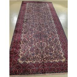An Antique Persian Kirman Style Wool Rug