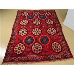 A Semi Antique Persian Shiraz Wool Rug with Animal Motif.