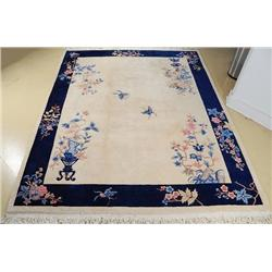 A Chinese Floral Wool Rug.