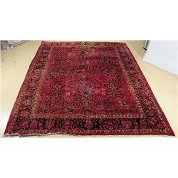 A Sino Persian Serapi Wool Rug.