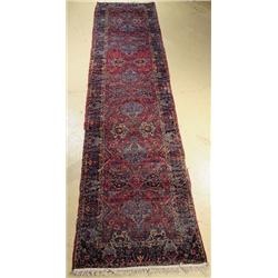 An Antique Persian Kirman Wool Runner.