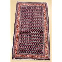 A Persian Mir Sarouk Wool Rug.