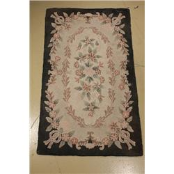 An Old Hooked Wool Rug.
