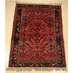 An Antique Persian Lilihan Wool Rug.