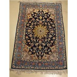 A Persian Isfahan Silk and Wool Rug.