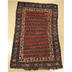 An Antique Kurd Caucasian Wool Rug.