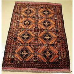 An Old Baluch Wool Rug.