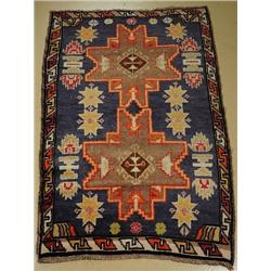 An Antique Turkish Lesgi Wool Rug.