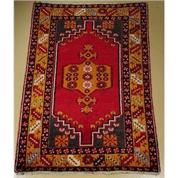 An Antique Turkish Oushak Wool Rug.