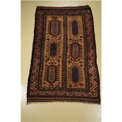 An Antique Persian Baluch Wool Rug.