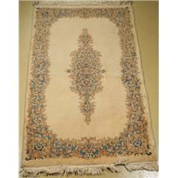 An Antique Persian Kirman Wool Rug,