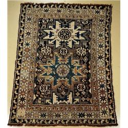 An Antique Caucasian Shirvan Lesgi Wool Rug.