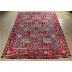 A Persian Kurk Kashan Wool Rug with Garden Motif.