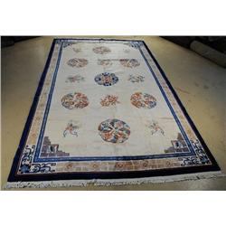 An Antique Chinese Palace Size Wool Rug.