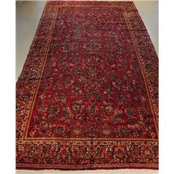 An Antique Persian Sarouk Wool Rug.
