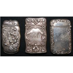 three Silver match cases