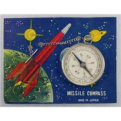 C. 1950'S TOY MISSILE COMPASS ON ORIG. CARD - MADE