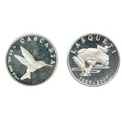 Lasqueti Mint. 1997/2007. Obv: LASQUETI/1997/2007. Frog. Rev: CASCADIA. ½ oz. .999 Fine. Hummingbird