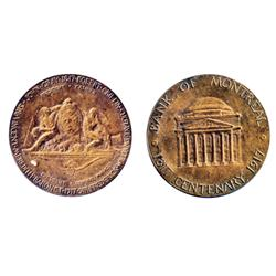 Obv: BANK OF MONTREAL/1817 CENTENARY. 1917. Building; Rev: Shield, with two Indians. Copper. 34mm. 2