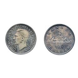 1937.  ICCS Mirror SPECIMEN-64.  Typical heavy blue and violet toning.  The bust exhibits a 'Cameo'