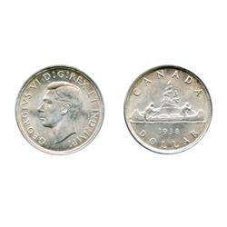1938.  CCCS graded Mint State-63.  A brilliant and lustrous silver dollar.