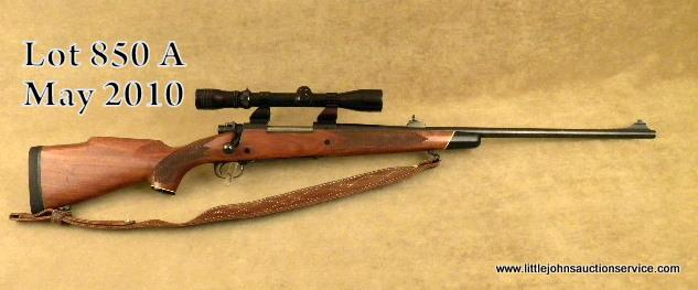 "Winchester Model 70 bolt-action rifle, 7mm Remington Mag  cal , 24"" barrel,  blue finish, checkered"