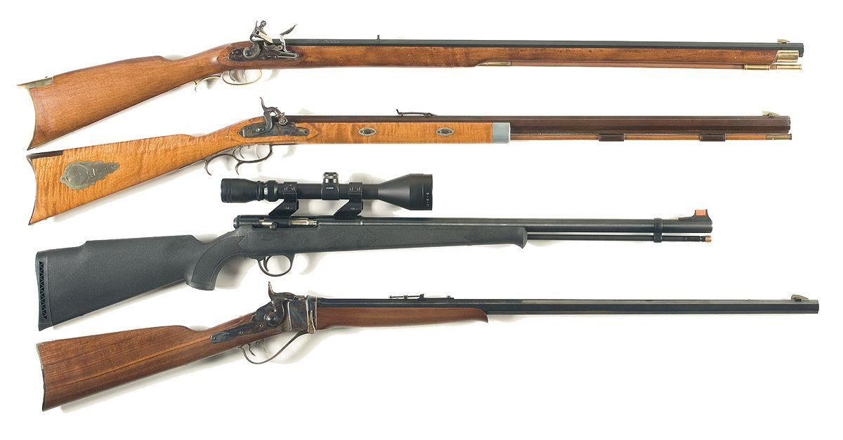 Four Rifles -A) Traditions Flintlock Rifle with Factory Box B) Connecticut  Valley Arms Percussion B