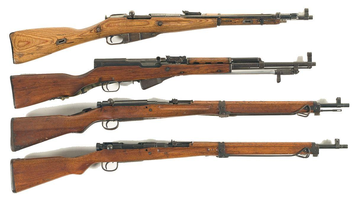 Four Long Guns -A) Russian Model 1944 Carbine B) Chinese SKS Semi-Automatic  Carbine C) Japanese Ty