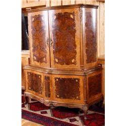 Antique French Armoire in burl walnut and maple with floral inlayed designs and claw feet. Center ca