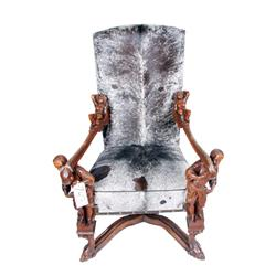 Superb Cowhide Upholstered European Tall Gentleman's arm chair, hand carved arms with cherubs, resti