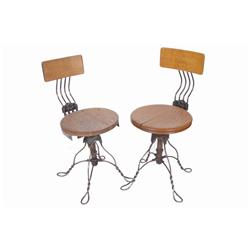 Set of Two Oak Telephone Operator Chairs with twisted steel legs and cast iron centers; adjustable b