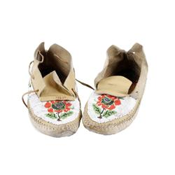 Pair of Beaded Moccassins showing florals, probably Shoshone. Shows repairs, resoling, and many rewo