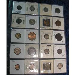 33. (20) Foreign Coins in a plastic page. Grades up to BU, Dates back to 1876.