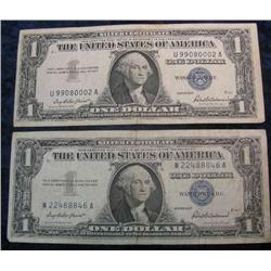 58. (2) Series 1957 $1 Silver Certificates. VG-F.