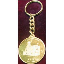 "218. 1881-1981 Keystone, Iowa Key ring with Centennial medal Stamped ""0118""."