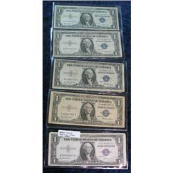 1704. (2) Series 1935E, 35F, 35G, & 57B $1 Silver Certificates. VG-F.