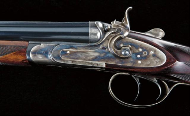 Exposed hammer double rifle,  45-70 caliber, by Pedersoli of Italy