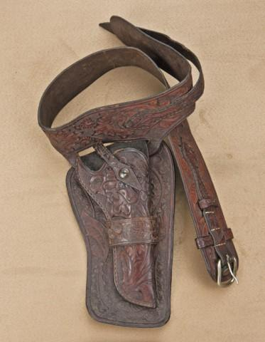 Lot of three Western style holsters including: 1) Double-loop holsters