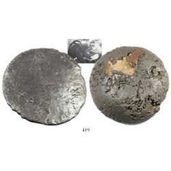 Large silver disk (contraband), 13.25 lb av (approx. 6000 grams).