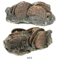 Clump of 12 Dutch East India Co. copper duits (should all be dated 1752) in encrustation.