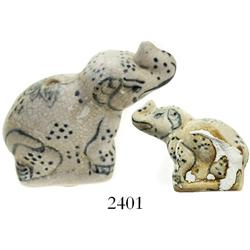 Small, blue-on-white Chinese porcelain elephant figurine.
