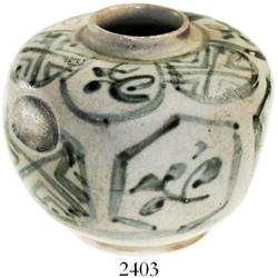 Small, hexagonal, blue-on-white Chinese porcelain vase.