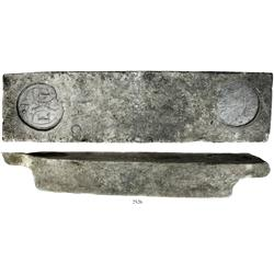 Large, well-formed tin ingot deeply marked with seals for the English East India Co. and the Cornish