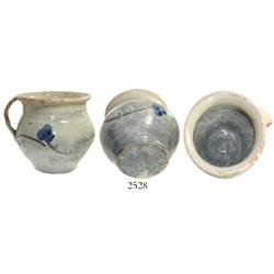 Glazed earthenware chamber-pot, blue flower pattern.