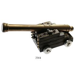 Small brass cannon and wooden carriage, probably 1900s.