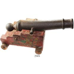 Small, iron cannon dated 1732 on painted canvas-on-wood carriage (modern).