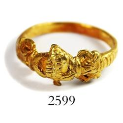 Ornate gold ring of hands clasping a heart, Spanish colonial (1600s-1700s), found in the southern Ca